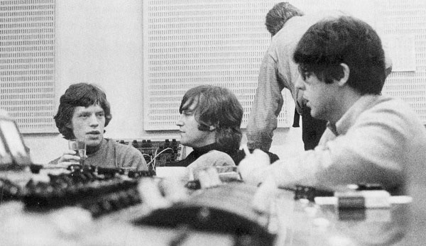 The Beatles in studio with Mick Jagger